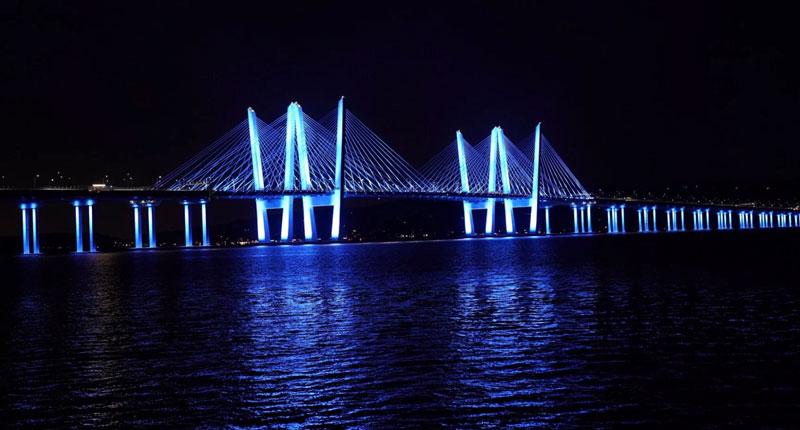 Mario Como Bridge at night lit up in blue lights.